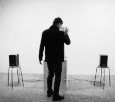 "Martti Mela performing with his installation ""Rain Dance""."